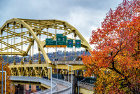 A close up view of the fall colors around the Ft. Duquesne Bridge in Pittsburgh