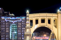 The top of the Clemente Bridge and the Bat Signal on the Renaissance