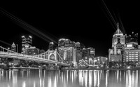 Lasers illuminate Bat Signals on downtown Pittsburgh in B&W