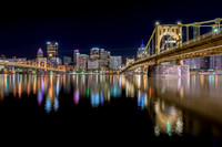 Downtown Pittsburgh and the Bat Signals reflect in the Allegheny River