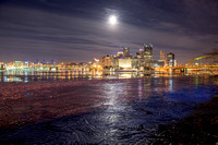 A full moon reflects in the icy Ohio River in Pittsburgh