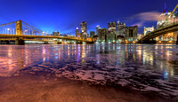 Colorful reflects on the icy Allegheny River in PIttsburgh