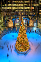 Skaters zip around the tree at PPG Place in Pittsburgh