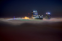 Pittsburgh rises above the fog before dawn