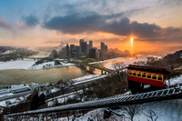 A sun pillar and the Duquesne Incline in Pittsburgh at dawn