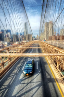 Car driving across the Brooklyn Bridge HDR