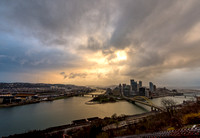 The sun shines through the clouds over Pittsburgh after a snow squall