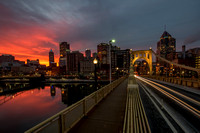 A vibrant Pittsburgh sunrise from the Clemente Bridge