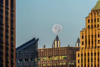 The moon rests on top of a spire at PPG Place in Pittsburgh