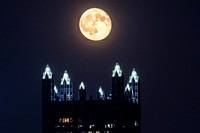 The moon hangs low over PPG Place in Pittsburgh