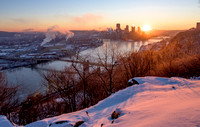 The snow glows pink at dawn from the West End in Pittsburgh