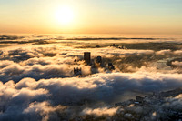 Aerial view of the Pittsburgh skyline covered in fog