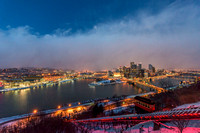 A snow squall moves through Pittsburgh above the Duquesne Incline