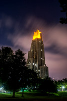 Clouds rush over the Victory Lights on the Cathedral of Learning after the Pitt vs. Penn State Game