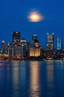 The moon shines bright over Pittsburgh from the West End