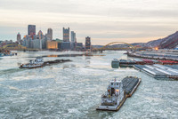 Two barges on Ohio River Pittsburgh ice West End Bridge