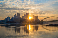 Sunflare through the Pittsburgh skyline at dawn
