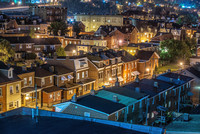 Lawrenceville houses glow before sunrise