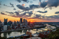 A bright sunrise over Pittsburgh in the summer