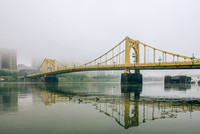 A foggy vew of the Roberto Clemente Bridge in Pittsburgh