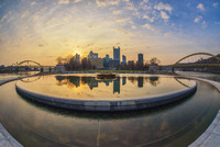 Pittsburgh reflects in the fountain pool at Point State Park at sunrise