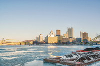Snow on the barge on a sunny day and ice on the rivers in Pittsburgh in winter