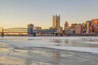 Pittsburgh skyline on the ice covered Monongahela River in the winter