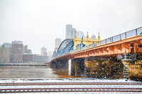 Snow falls around the Smithfield Street bridge in Pittsburgh