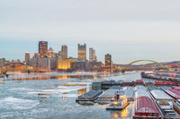 Barge at dock Pittsburgh skyline Ice West End Bridge