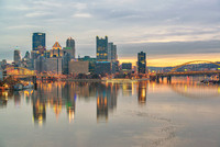 Pittsburgh glows at dawn from the West End Bridge in the winter