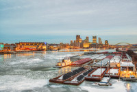 Barges glow on the icy Ohio River Pittsburgh in the winter