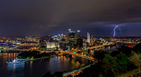 Lightning strikes behind the PIttsburgh skyline at night