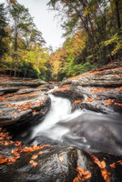 View down the natural rock slides at Ohiopyle State Park in the fall