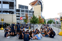 Students wait outside Heinz Field before the Pitt vs. Penn State game