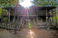Sunflare over main cabin at Log Cabin Village HDR
