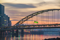 The Ft. Pitt Bridge in Pittsburgh in front of the morning sky