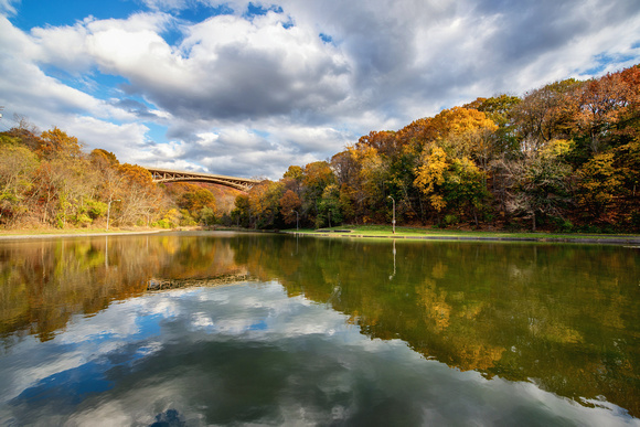 Clouds and fall colors reflect in Panther Hollow Lake