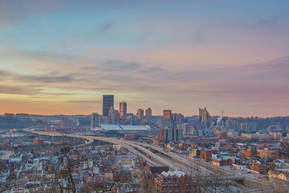 A colorful sky dawns over Pittsburgh from the North Side