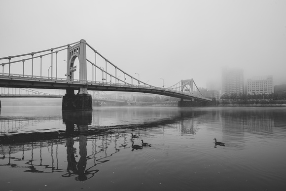 A B&W view of the Andy Warhol Bridge through the fog in Pittsburgh