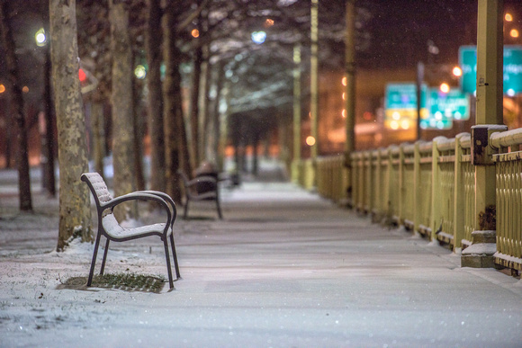 A snowy bench sits in downtown Pittsburgh