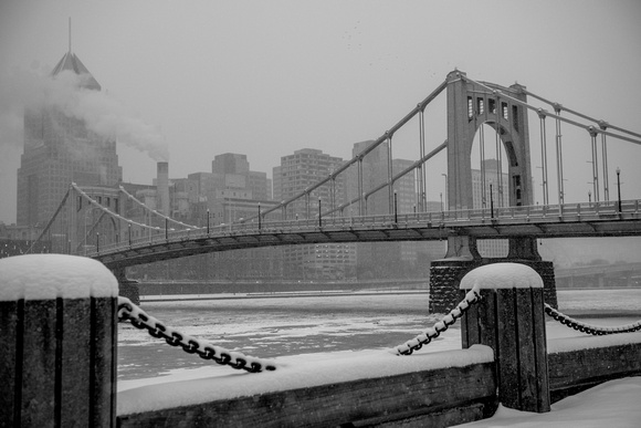 Black and white view of snow falling on Allegheny Landing