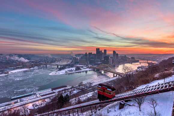 The Duquesne Incline climbs Mt. Washington in Pittsburgh during a vibrant winter sunrise
