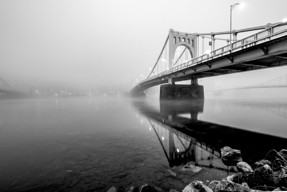The Clemente Bridge disappears into the fog in Pittsburgh