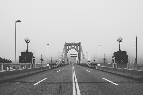 A B&W view of the Roberto Clemente Bridge in the fog in Pittsburgh