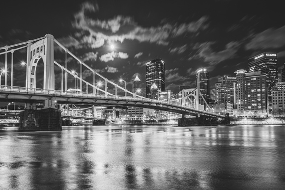 Black and white view of the full moon over Pittsburgh