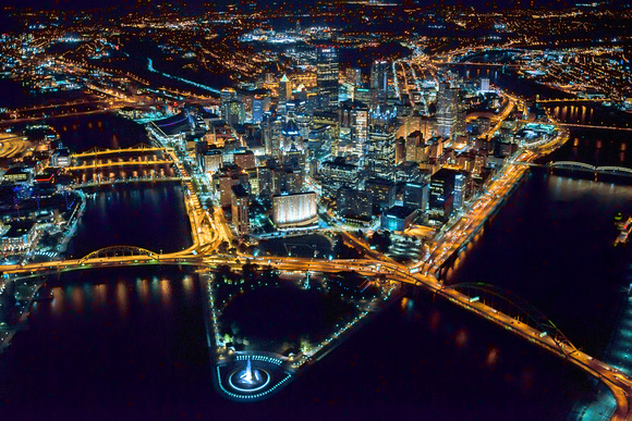 A beautiful view of Pittsburgh from above at night