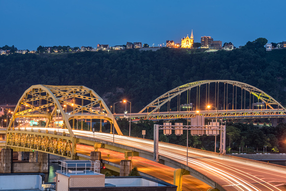 Cars streak over the Ft. Duquesne Bridge in PIttsburgh