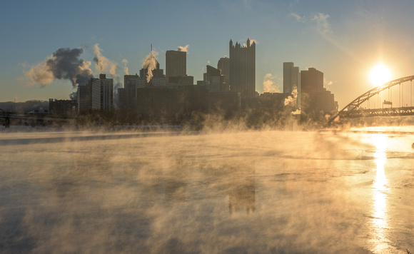 Steam rises from the ice on a cold Pittsburgh morning