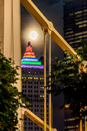 The Andy Warhol Bridge frames the moon and the Gulf Tower