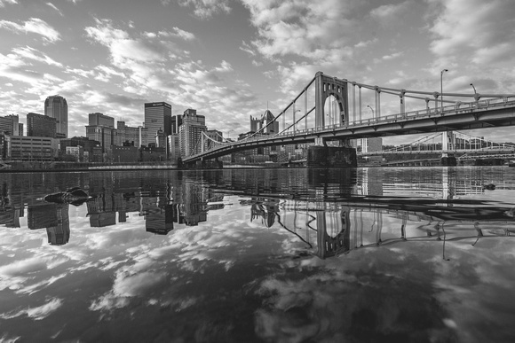Pittsburgh and the clouds above reflect in the Allegheny